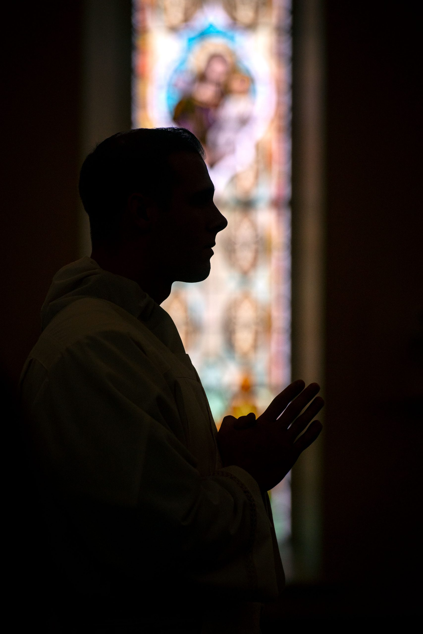 Father Martuscello stands in the front of St. Mary Church at the start of the ordination Mass.