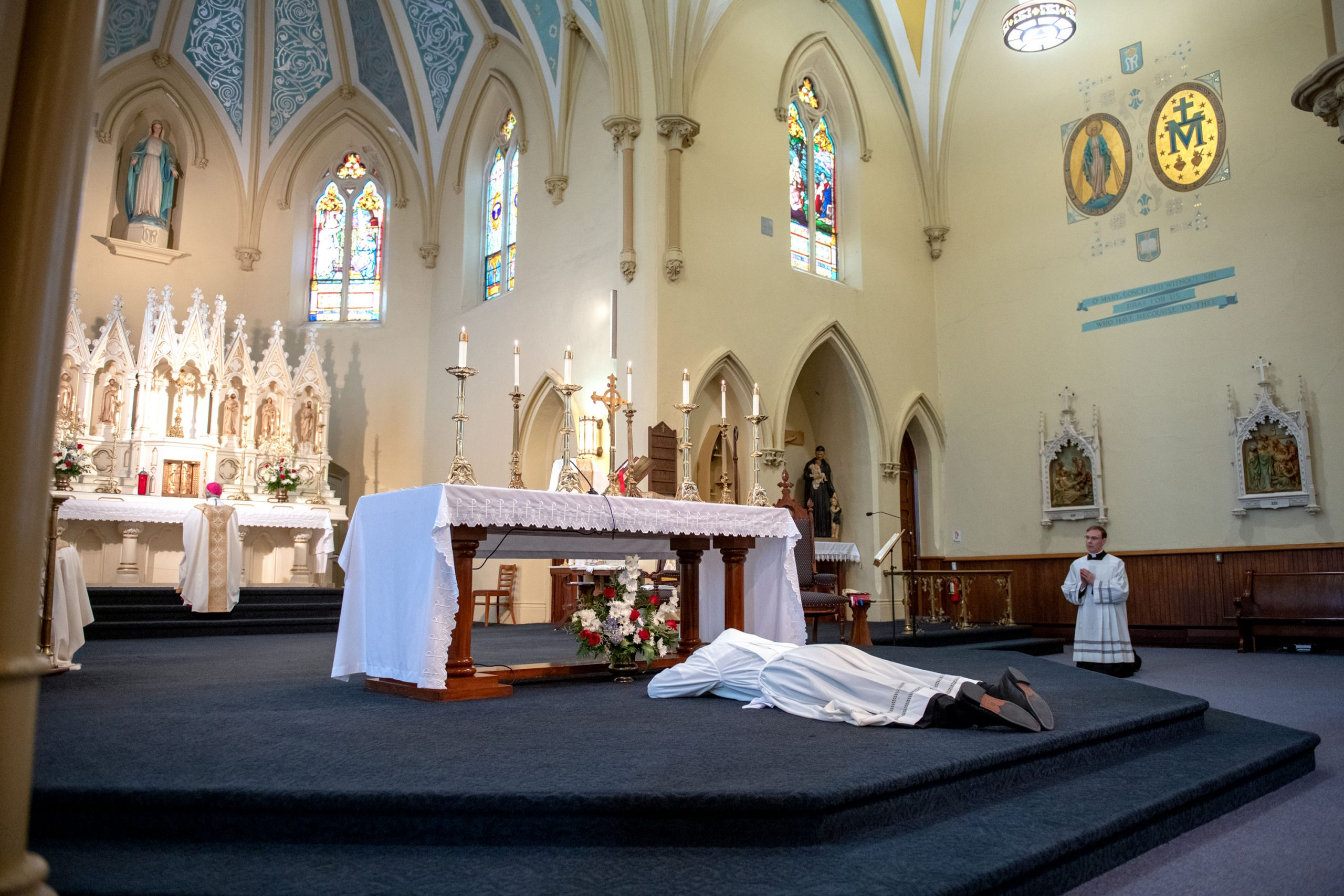 Father Martuscello prostrates at the altar during Litany of Saints.