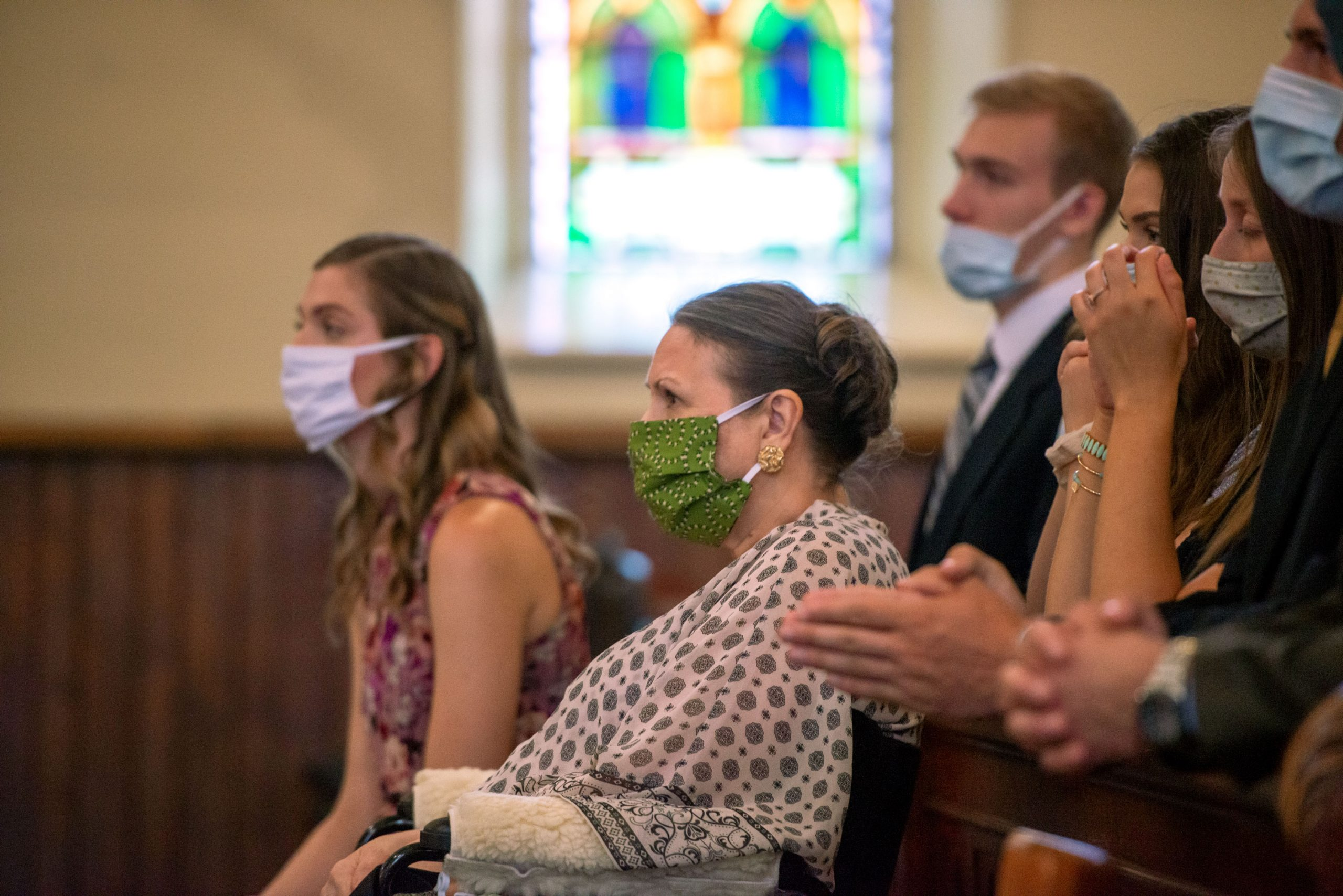 Father Martuscello's mother sits with her family during the Mass.