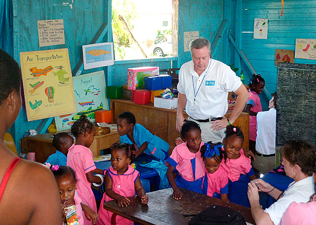 Deacon Kevin Carges visits the original High House Basic School in McCook's Pen, Jamaica, in February before joining the students for the inauguration of their new school building.