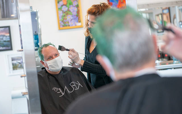 <p>Deacon Kevin Carges has his hair dyed green Oct. 30 at Icon Hair Salon and Spa in Canandaigua. He promised donors who helped him raise $5,000 in donations for Catholic Relief Services that he would dye his hair a shocking color and shave the letters &ldquo;CRS&rdquo; into the side of his head. (Courier photo by Jeff Witherow)  </p>