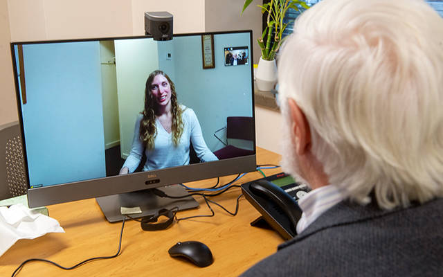 <p>In 2019, Dr. Robert Young and Jessica Pruitt demonstrated the capabilities of Catholic Family Center&rsquo;s new telehealth service, which allows clients at the agency&rsquo;s clinics and residential treatment centers to see their providers remotely. (Courier file photo)  </p>