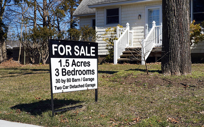<p>A real estate sign is seen outside a house up for sale in Stony Brook, N.Y., March 5, 2021. (CNS photo by Gregory A. Shemitz)  </p>