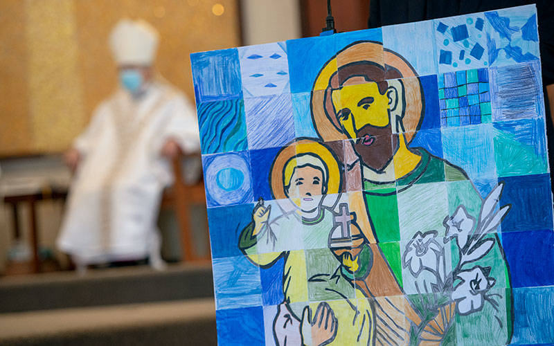 <p>During a St. Joseph&rsquo;s Day Mass at St. Joseph Church in Penfield March 19, Bishop Salvatore R. Matano is seen behind an image of the saint that was created by students at St. Joseph School. (Courier photo by Jeff Witherow)  </p>