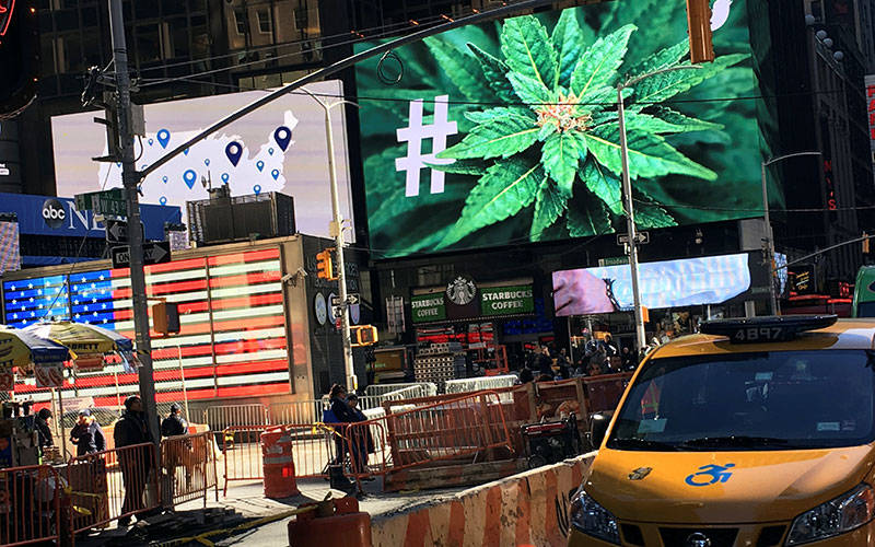 <p>In this 2016 file photo, a billboard in New York City displays a marijuana hashtag. The New York State Catholic Conference called on the state&rsquo;s legislators to reject any proposal that would legalize recreational marijuana use. (CNS photo by Shannon Stapleton/Reuters)  </p>