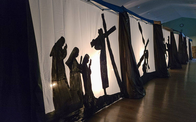 <p>St. Catherine of Siena Church in Mendon created a self-guided Shadow Stations of the Cross in its community center. The stations comprise painted, backlit panels and will be open through Holy Week. (Courier photo by Jeff Witherow)  </p>