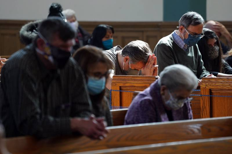 <p>Worshippers pray during a bilingual memorial Mass March 13, 2021, for parishioners who have died from COVID-19 at St. John-Visitation Church in the Bronx borough of New York. The Centers for Disease Control and Prevention announced April 27 that fully vaccinated people wearing masks can safely attend indoor worship services. (CNS photo by Gregory A. Shemitz)  </p>