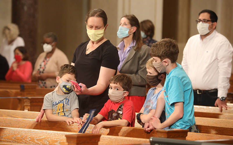 <p>A family prays the rosary at the Basilica of the National Shrine of the Immaculate Conception in Washington May 17, 2021. The rosary, led by Washington Cardinal Wilton D. Gregory, was part of a worldwide effort called by Pope Francis to pray for an end to the coronavirus pandemic. (CNS photo by Andrew Biraj/Catholic Standard)  </p>