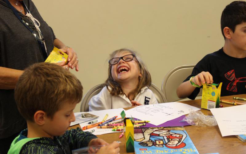 Alexandria Capuzzi smiles as she enjoys learning about the Mass at Sts. Simon and Jude Parish religious education program in West Chester, Pa.(CNS photo by Sts. Simon and Jude Parish)