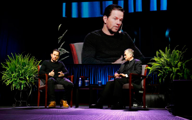 Actor Mark Wahlberg and and Cardinal Blase J. Cupich of Chicago discuss faith and the life of young adults during a re(ENCOUNTER) event at the UIC Pavilion Oct. 20.