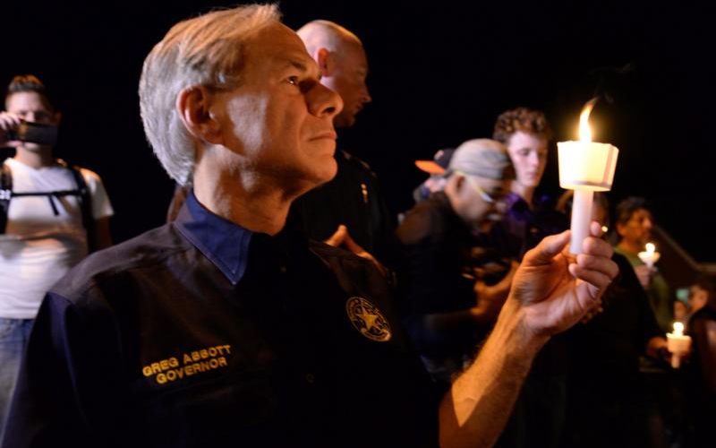 Texas Gov. Greg Abbott, who is Catholic, attends a candlelight vigil after a mass shooting Nov. 5 at the First Baptist Church in rural Sutherland Springs. A lone gunman entered the church during Sunday services taking the lives of at least 26 people and injuring several more. (CNS photo by Joe Mitchell/Reuters)