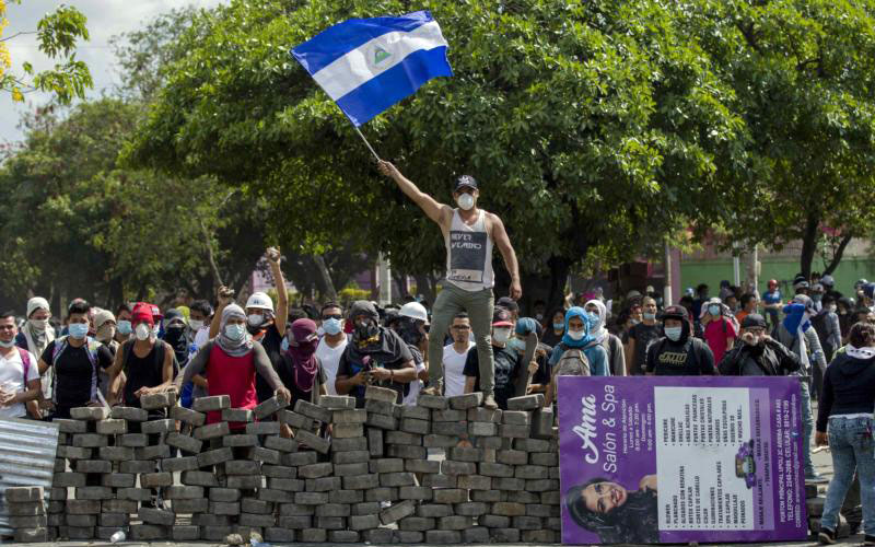 People demonstrate near a cobblestone barricade in Managua, Nicaragua, April 21. Pope Francis called for an end to violence in Nicaragua after several days of protests against proposed social security legislation led to the deaths of more than two dozen people. (CNS photo by Jorge Torres/EPA)