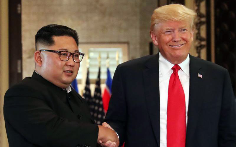 North Korea's leader Kim Jong Un and U.S. President Donald Trump shake hands after signing documents during a summit at the Capella Hotel on the resort island of Sentosa in Singapore June 12. Signing a joint statement, President Trump agreed to provide security guarantees to North Korea and Chairman Kim reaffirmed his commitment to the complete denuclearization of the Korean Peninsula. (CNS photo by Jonathan Ernst/Reuters)