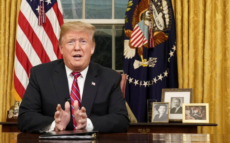 U.S. President Donald Trump delivers an address Jan. 8 televised to the nation from his desk in the Oval Office at the White House in Washington. He spoke about immigration and the southern U.S. border on the 18th day of a partial government shutdown. (CNS photo by Carlos Barria/Reuters)