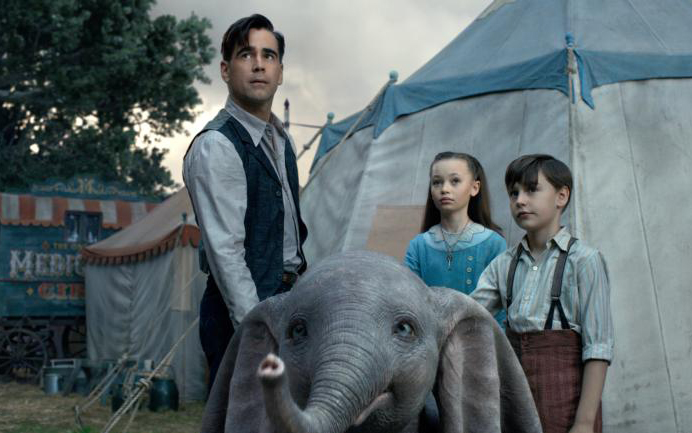 "Colin Farrell, Nico Parker and Finley Hobbins star in a scene from the movie ""Dumbo."" (CNS photo by Disney)"