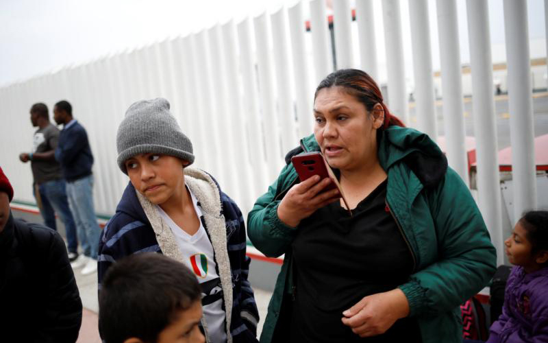 Asylum seeker Antonia Portillo Cruz speaks on the phone in Tijuana, Mexico, April 25, 2019, before crossing to the U.S. to appear in front of an immigration judge. (CNS photo by Andres Martinez Casares/Reuters)