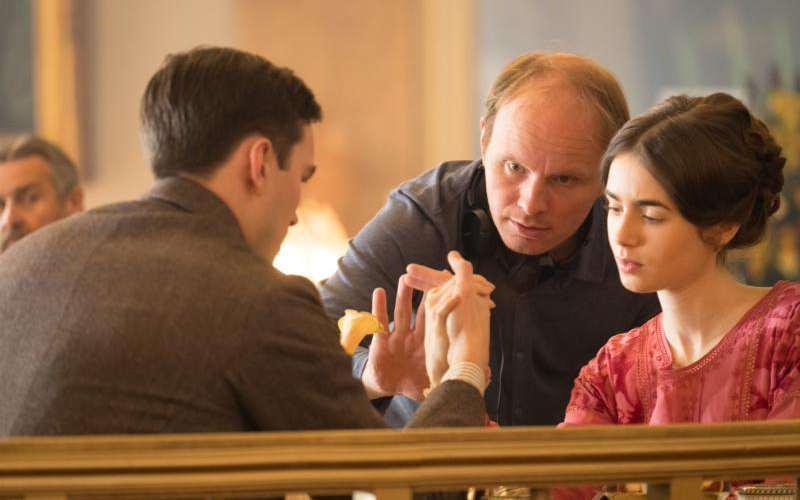 """Nicholas Hoult, director Dome Karukoski and Lily Collins are seen on the set of the movie """"Tolkien."""" (CNS photo by Fox Searchlight)"""