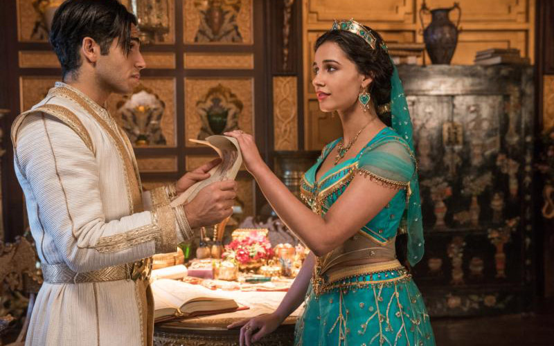 "Mena Massoud and Naomi Scott star in a scene from the movie ""Aladdin."" (CNS photo by Disney)"