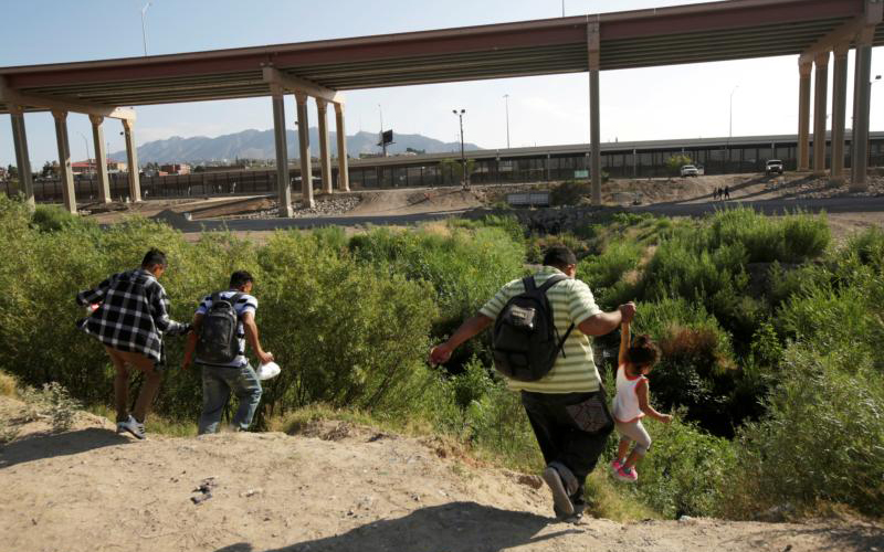 Migrants in Ciudad Juarez, Mexico, try to cross into El Paso, Texas, May 31, 2019. (CNS photo by Jose Luis Gonzalez/Reuters)
