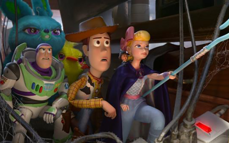 "Animated characters Buzz Lightyear, voiced by Tim Allen, Woody, voiced by Tom Hanks, and Bo, voiced by Annie Potts, appear in the movie ""Toy Story 4."" (CNS photo by Disney)"