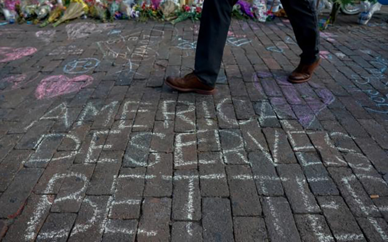 A man walks past a memorial Aug. 7, 2019, for those killed in a mass shooting in Dayton, Ohio, four days earlier. (CNS photo by Bryan Woolston/Reuters)