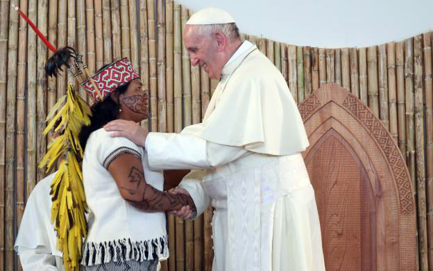 Pope Francis is greeted by a member of an indigenous group from the Amazon region during a meeting at the Coliseo Regional Madre de Dios in Puerto Maldonado, Peru, Jan.19, 2018. (CNS photo by Alessandro Bianchi/Reuters)