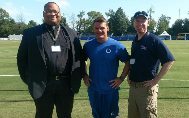 Father Douglas Hunter, Catholic chaplain for the Indianapolis Colts football team, is pictured in an undated photo with Colts general manager Chris Ballard and Dave Neeson of Catholic Athletes for Christ.