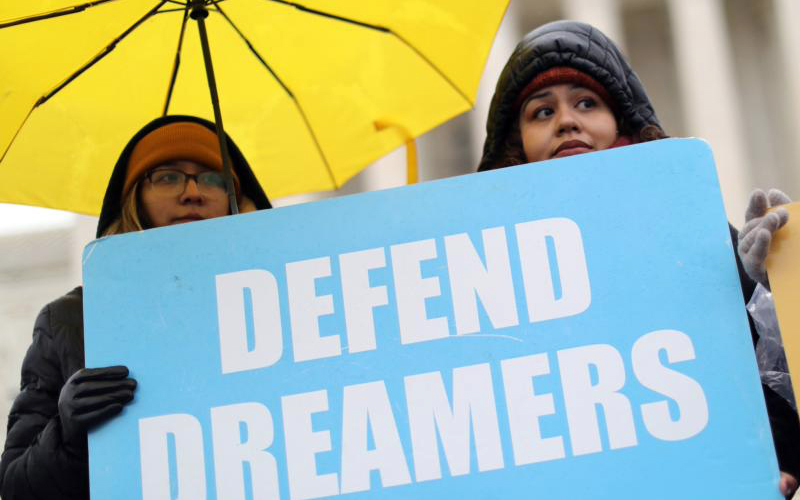 DACA demonstrators hold signs outside the U.S. Supreme Court in Washington Nov. 12, 2019, as justices hear oral arguments in a legal challenge to the Trump administration's bid to end the Deferred Action for Childhood Arrivals. (CNS photo by Jonathan Ernst/Reuters)