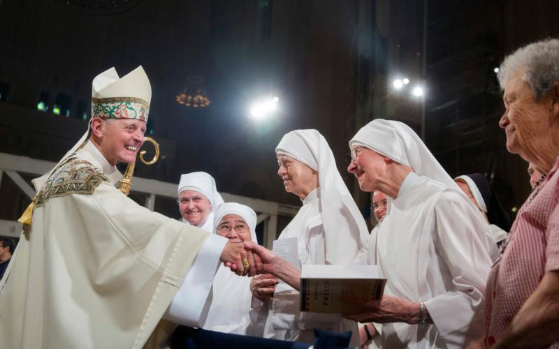 Cardinal Donald W. Wuerl greets members of the Little Sisters of the Poor after the closing Mass of the Fortnight for Freedom at the Basilica of the National Shrine of the Immaculate Conception in Washington
