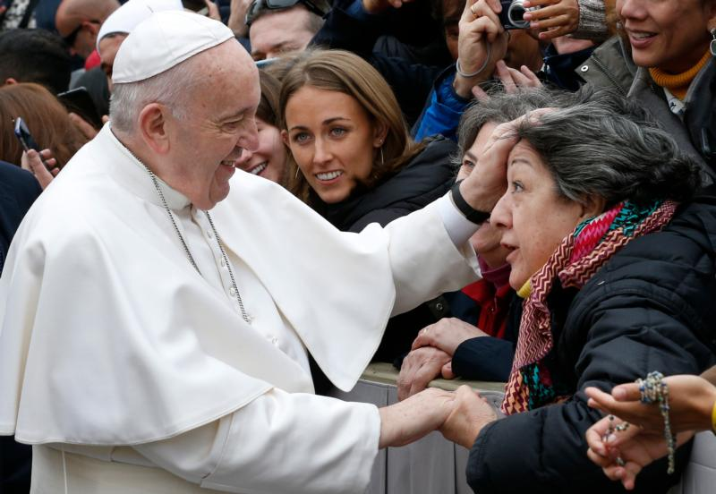 Pope Francis greets the crowd during his general audience in St. Peter's Square at the Vatican Feb. 26, 2020.