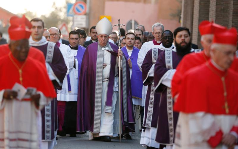 Pope Francis arrives in procession to celebrate Ash Wednesday Mass at the Basilica of Santa Sabina in Rome Feb. 26, 2020.