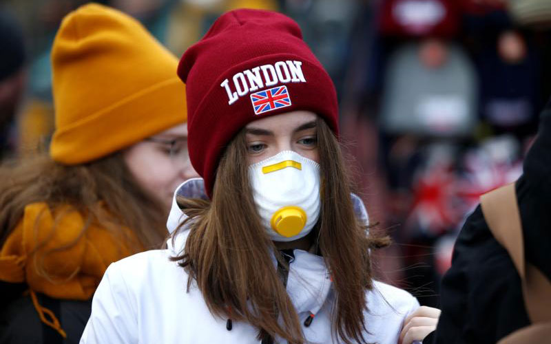 A girl wearing a coronavirus-related protective face mask is pictured in London March 2, 2020.