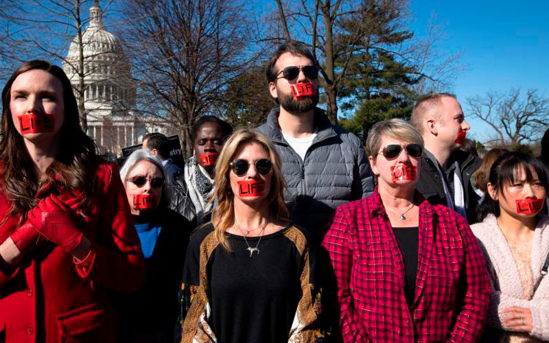 Pro-life activists are seen near the U.S. Supreme Court in Washington March 4, 2020.