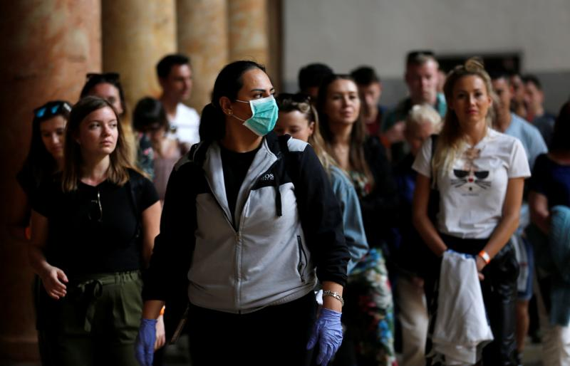 A tourist wearing a mask as a preventive measure against the coronavirus visits the Church of the Nativity in Bethlehem, West Bank, March 5, 2020.