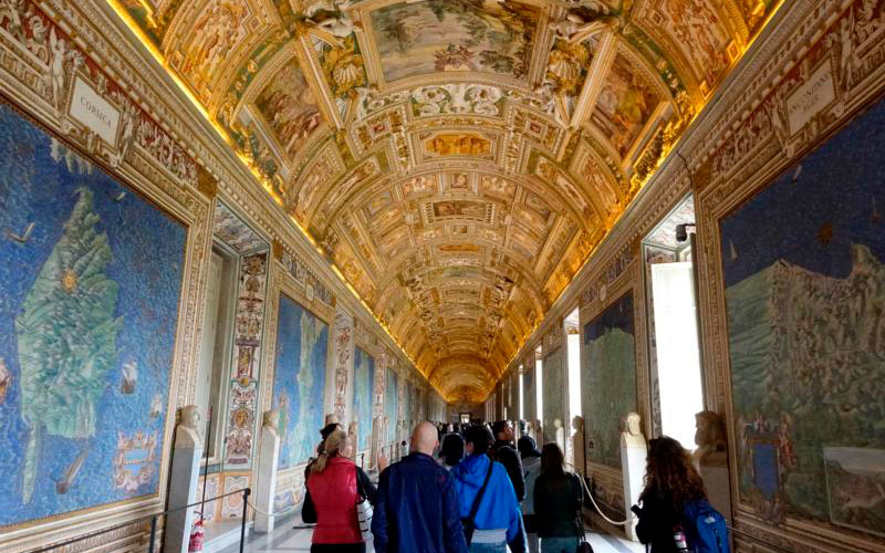 People tour the Vatican Museums at the Vatican in this Feb. 29, 2020, file photo.