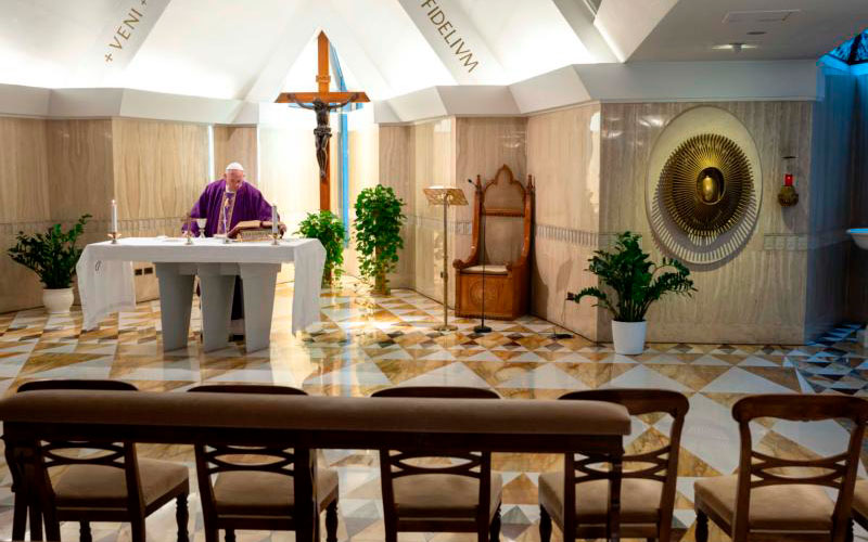 Pope Francis celebrates Mass in the chapel of his residence, the Domus Sanctae Marthae, at the Vatican March 10, 2020.