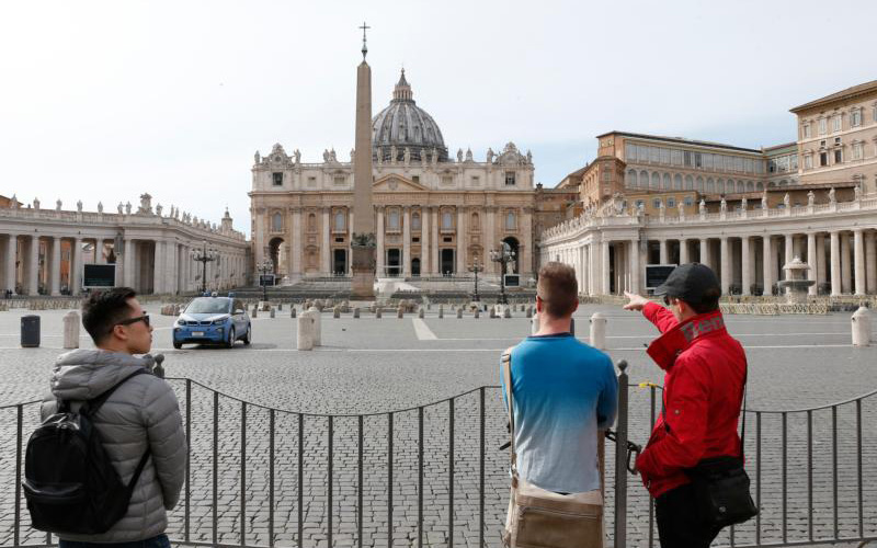 People look at an empty St. Peter's Square at the Vatican March 10, 2020.