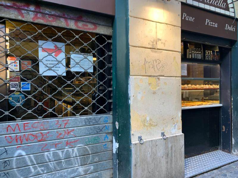A sign on the door of a popular bakery in Rome's Trastevere neighborhood advises customers that they cannot go inside but can buy bread through the window March 11, 2020.