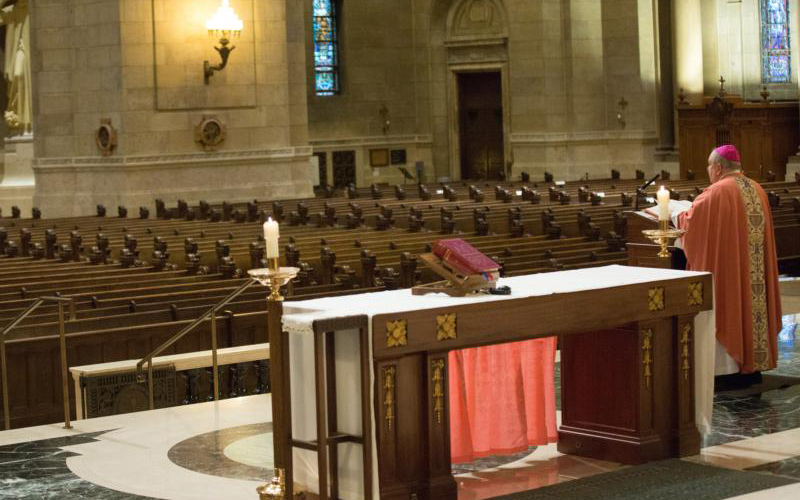 Archbishop Bernard A. Hebda of St. Paul and Minneapolis delivers his homily in an empty Cathedral of St. Paul March 21, 2020.