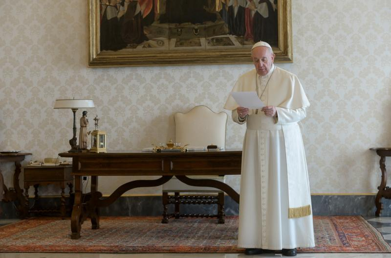 Pope Francis leads a global recitation of the Lord's Prayer from the library of the Apostolic Palace at the Vatican March 25, 2020.