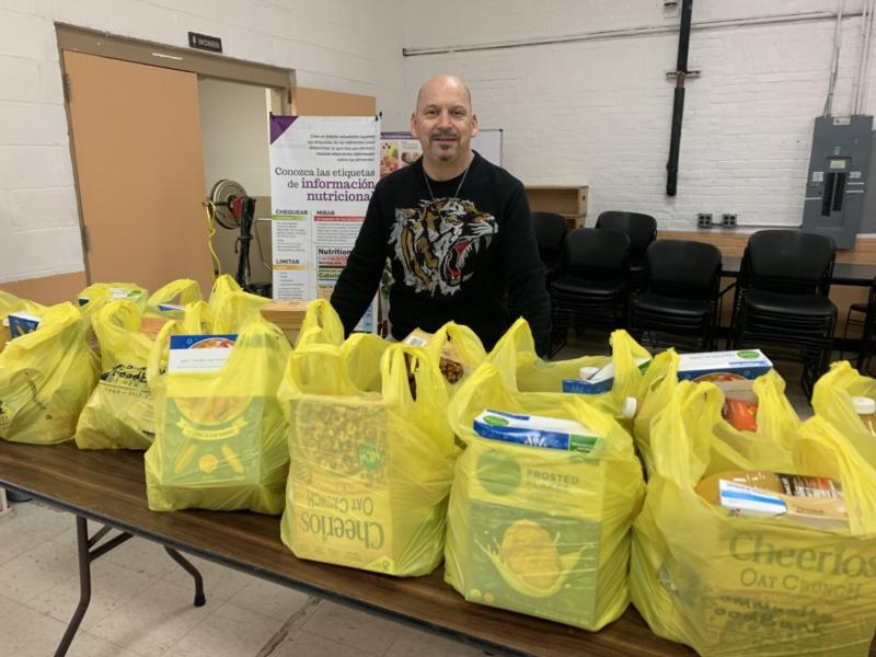 Carlos Roldan, director of Catholic Charities, Diocese of Paterson, N.J., Food Pantries, is shown with pre-packed bags of food March 23, 2020, ready to be distributed to people impacted by the coronavirus (COVID-19) pandemic.