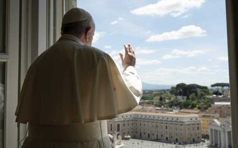 """Pope Francis gives his blessing from the window of the library in the Apostolic Palace May 3, 2020, after a live transmission of the """"Regina Coeli."""""""