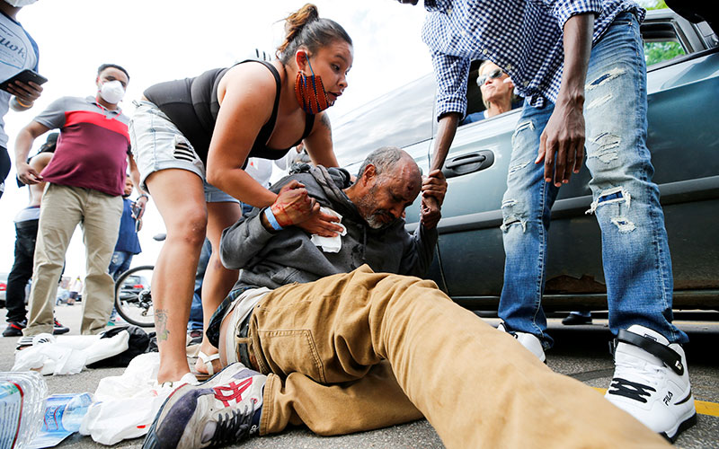 A man in Minneapolis is injured after being hit in the head by an object at a protest near the Minneapolis Police Third Precinct May 27, 2020.