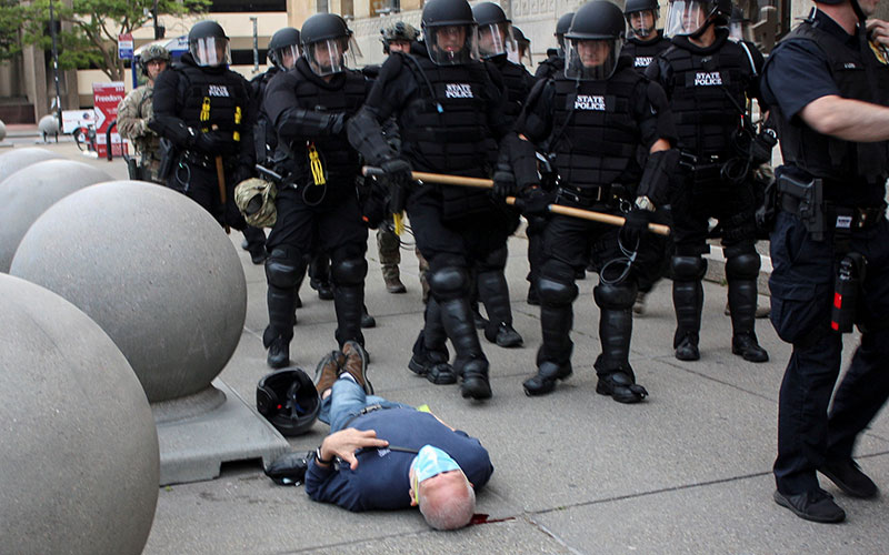 Martin Gugino lies on the ground after he was shoved by two Buffalo police officers June 4, 2020, during a protest against police violence against minorities.