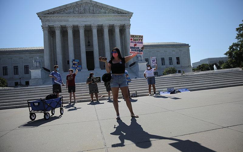 Pro-life activists gather outside the U.S. Supreme Court in Washington June 29, 2020.