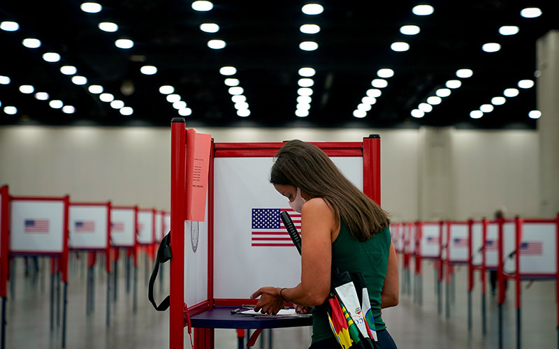 A woman in Louisville, Ky., votes during the primary election June 23, 2020, during the coronavirus pandemic.
