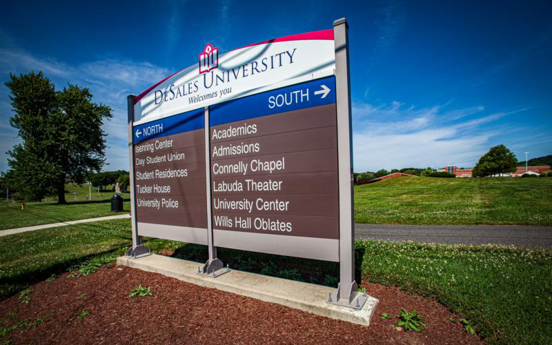 A DeSales University welcome sign directs traffic to different parts of the school's Center Valley, Pa., campus, July 26, 2020.