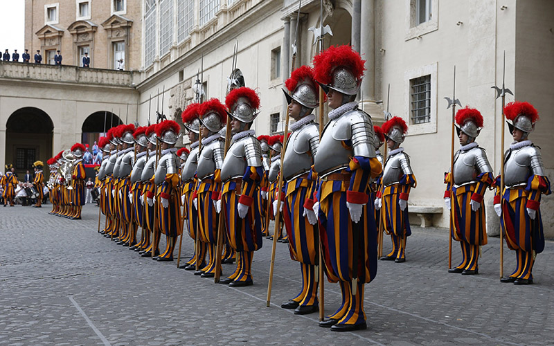 New Swiss Guard members stand at attention during their swearing-in ceremony in the Vatican's San Damaso courtyard in this May 6, 2015, file photo