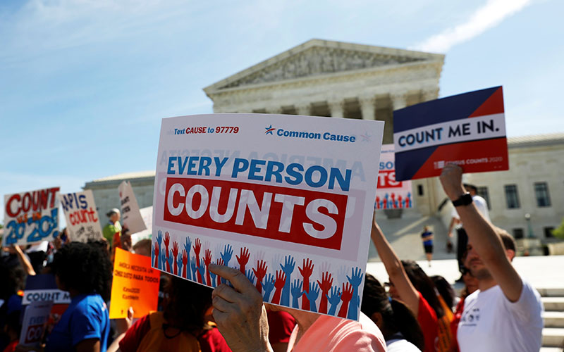 Demonstrators gather outside the U.S. Supreme Court in Washington April 23, 2019, following oral arguments on a citizenship question for the census.