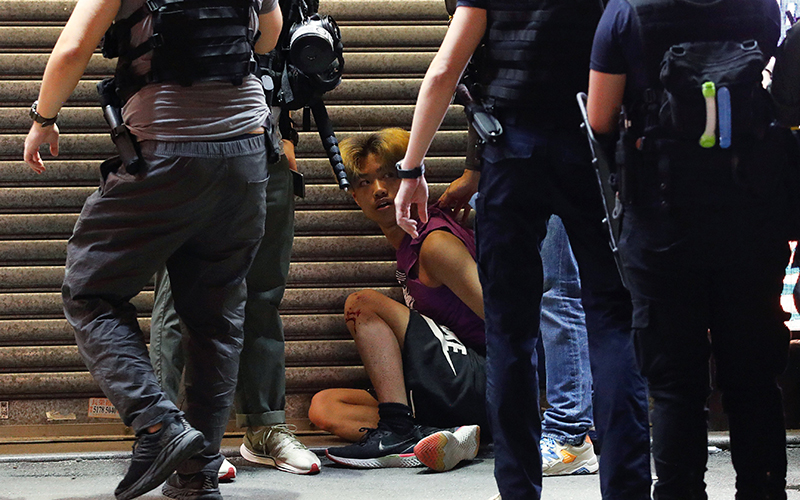 Riot police detain a man during a Sept. 6, 2020, protest in Hong Kong against postponed elections.